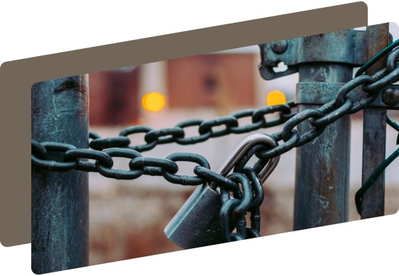 gate with a chain and a lock on it